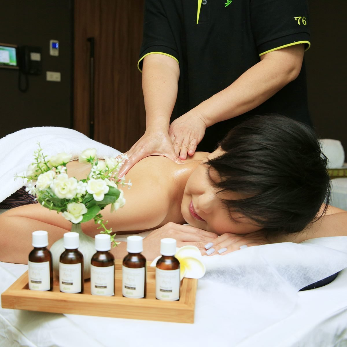 model-is-massaging-and-essential-oil